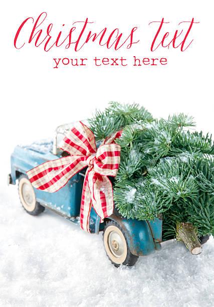 blue spielzeuglaster für einen weihnachtsbaum auf weißem hintergrund - alte weihnachtsbäume stock-fotos und bilder