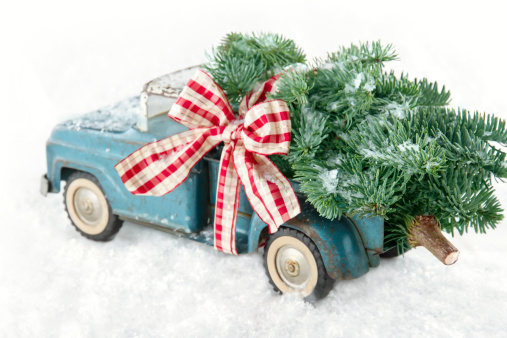 Blue Toy Truck Carrying A Christmas Tree Stock Photo - Download Image Now