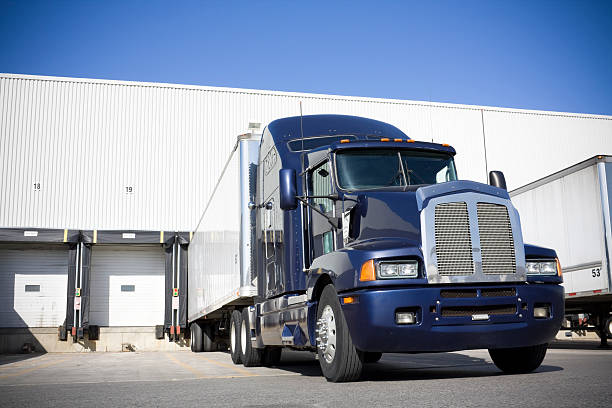 Blue transport truck docking at warehouse picture id104283402?b=1&k=6&m=104283402&s=612x612&w=0&h=n05waw8orpcjwlkcr6rh3nmlli4goyuulddiosxi8ww=