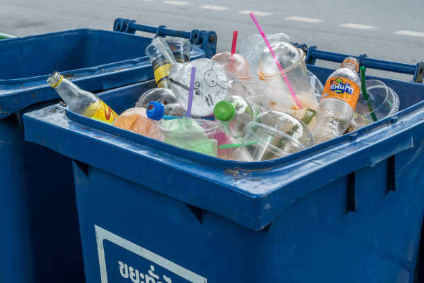 Blue trash bin full of garbage plastic waste trash. Trash plastic pollution. stock photo