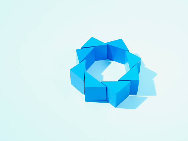 Blue triangles arranged in a circle stock photo