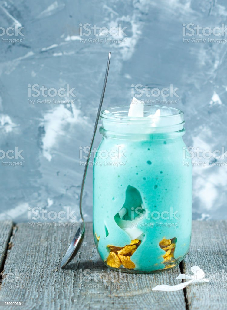 Blue tropical smoothie with coconut in a jar. stock photo