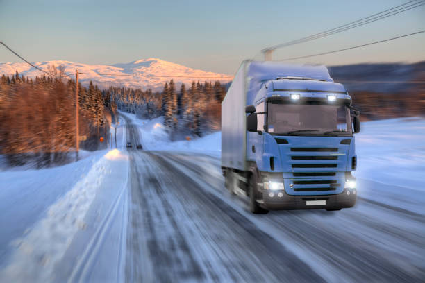 Blue truck driving on road stock photo
