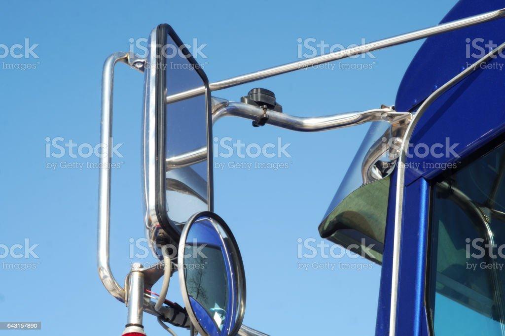 blue truck mirror close up stock photo
