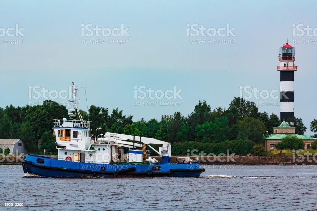 Blue tug ship underway stock photo