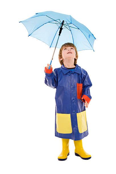 blue regenschirm jungen - kinder winterstiefel stock-fotos und bilder