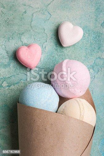 656780900istockphoto Blue, vanilla and strawberry bath bombs 656780968