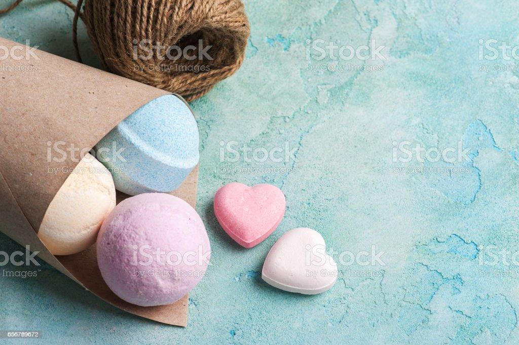 Blue, vanilla and strawberry bath bombs stock photo