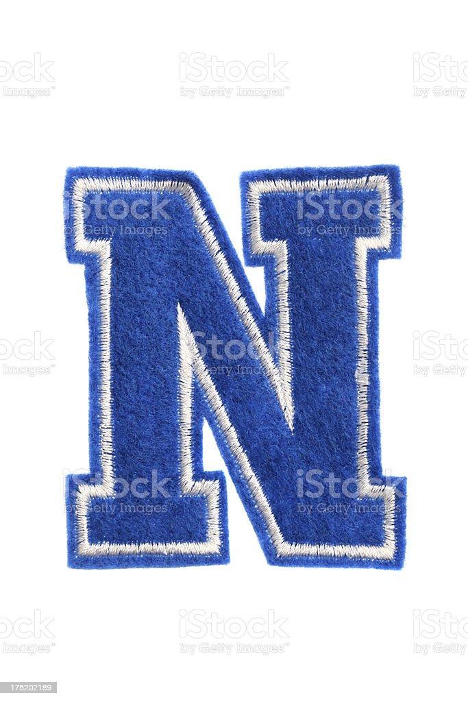 Blue Varsity college-Buchstabe N-sown Muster. – Foto