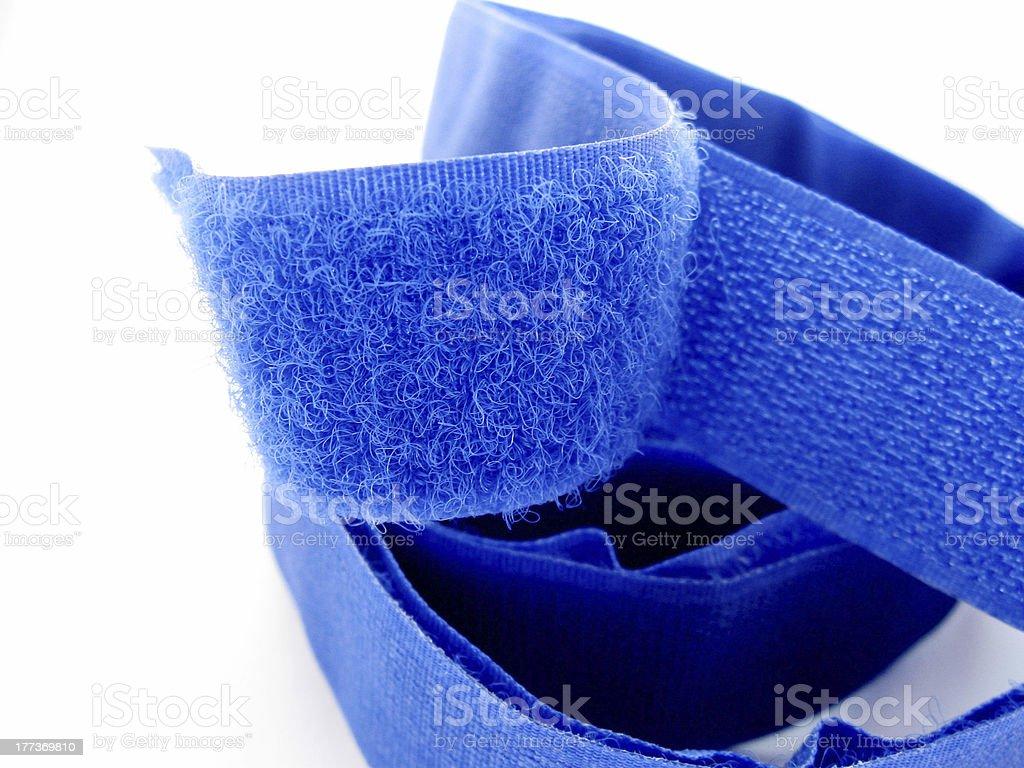 Blue Velcro strap against white background stock photo