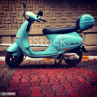 Istanbul, Turkey  - October 31, 2014: Blue Vespa parked on Istanbul street, Turkey