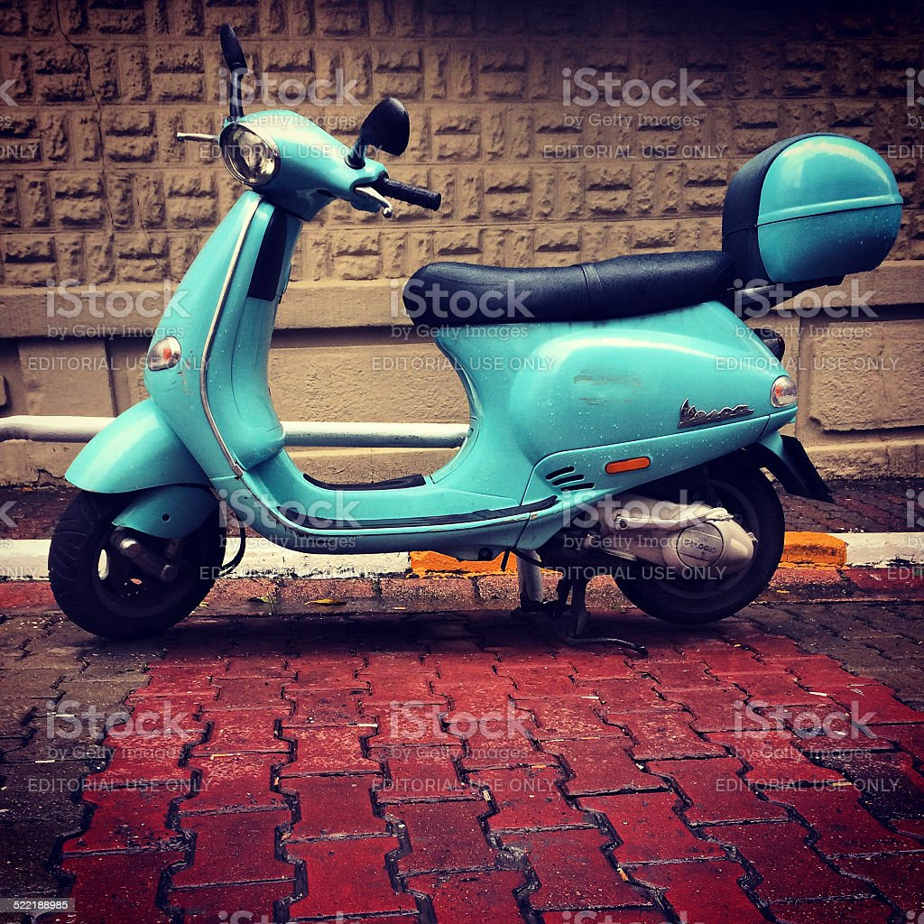 Blue Vespa parked on Istanbul street, Turkey stock photo