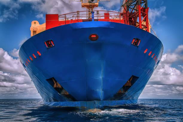 Blue vessel in the ocean stock photo