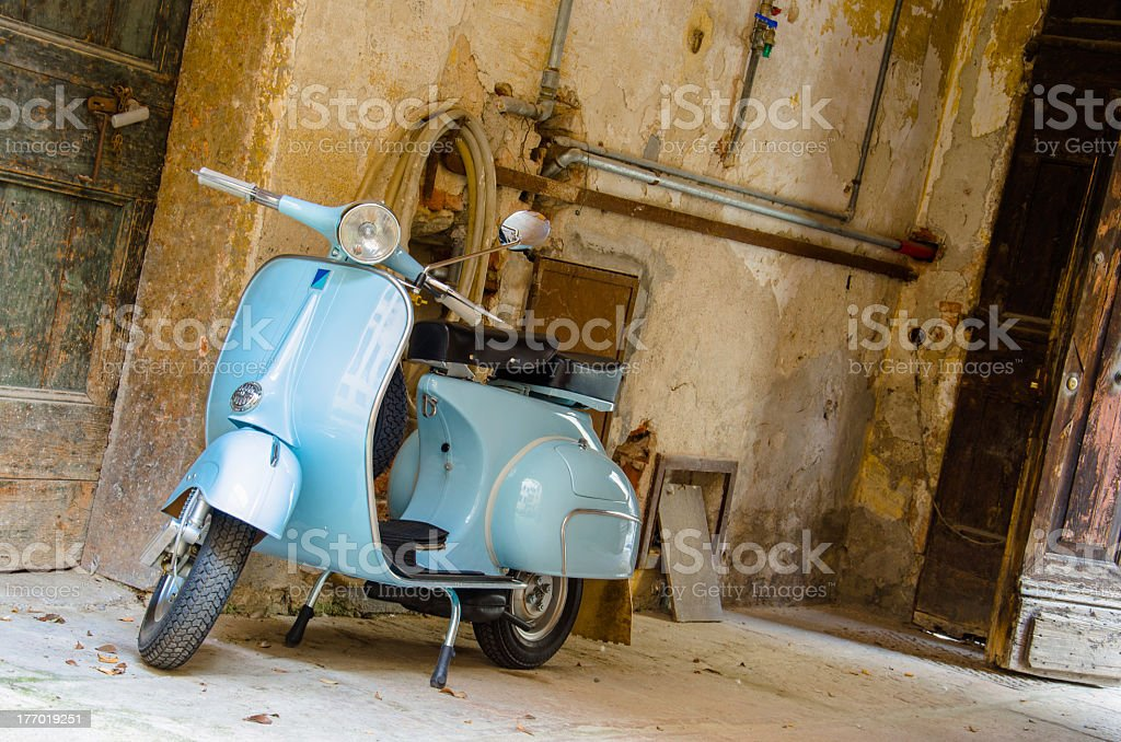 Blue vintage moped in an old garage royalty-free stock photo