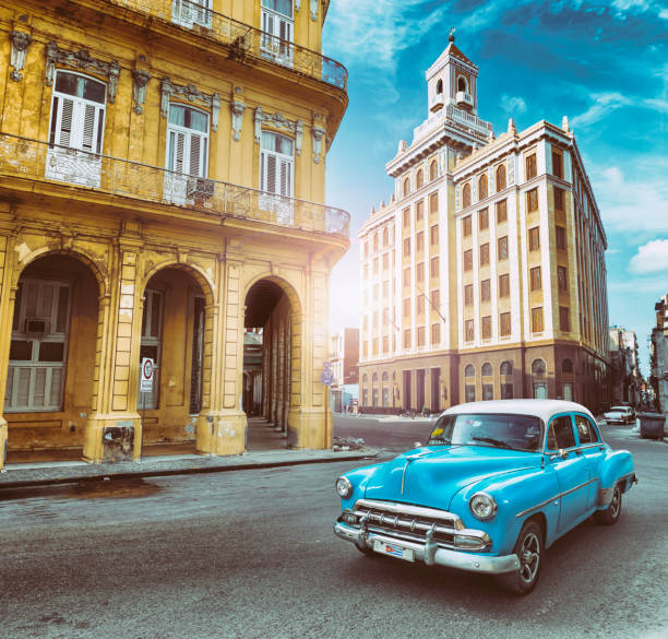 Blue vintage oldtimer car driving through Old Havana Cuba stock photo