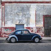 Merida, Yucatan, Mexico - 31 October 2018: Blue Oldtimer Volkswagen Beetle in the colonial street