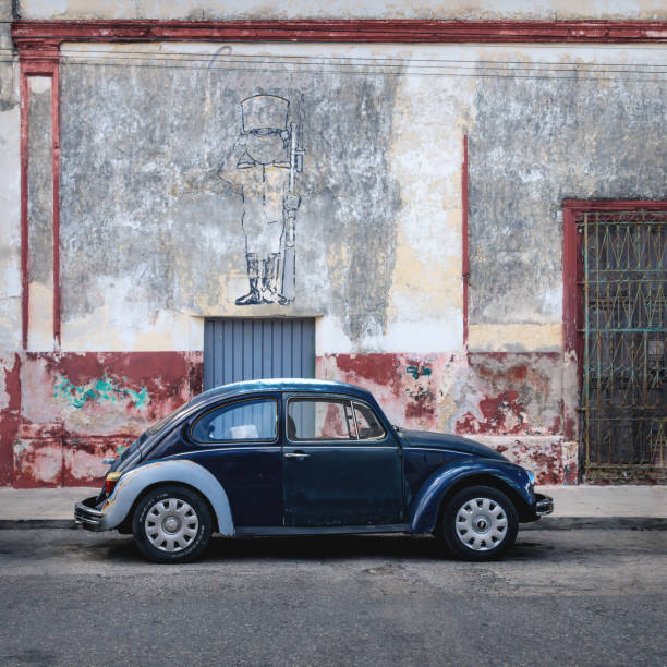 Blue Volkswagen Beetle in the colonial street of Merida, Yucatan, Mexico stock photo