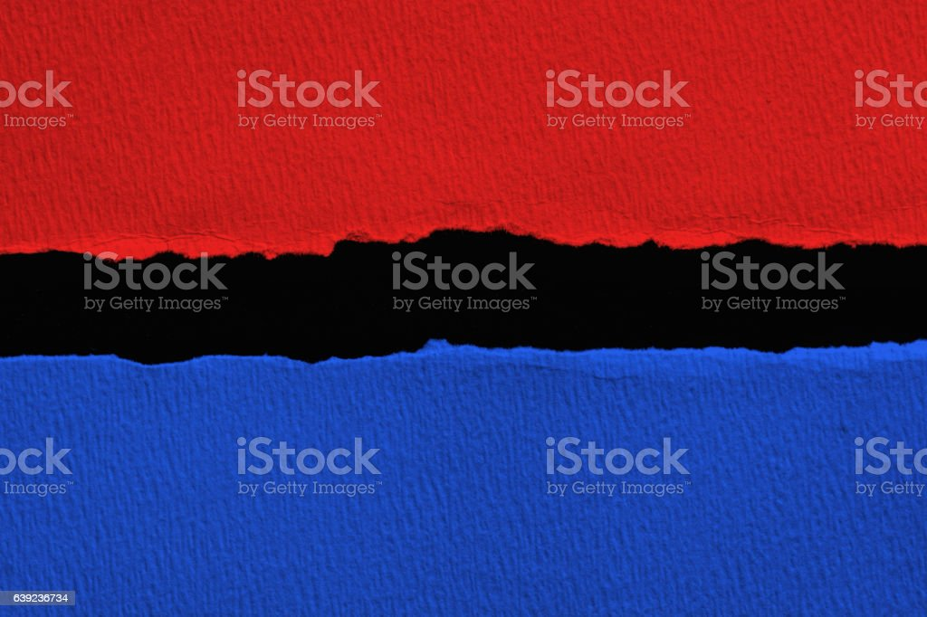 Blue vs red torn paper with black  space for text stock photo