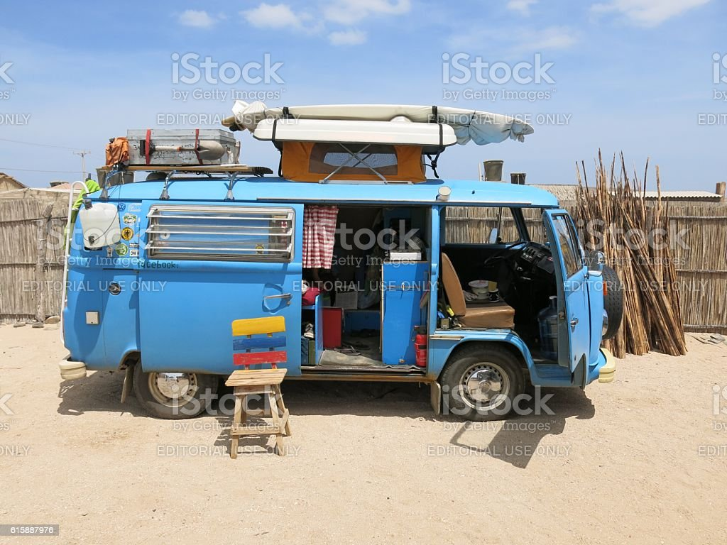 blue VW Bus Camper parked in Colombian desert stock photo