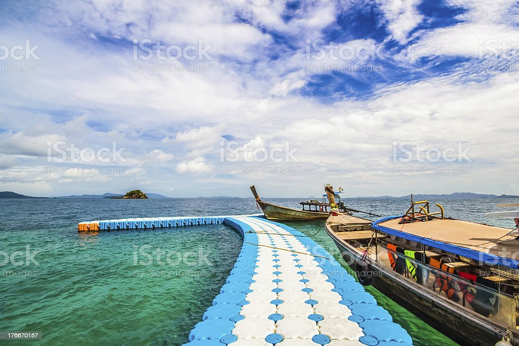 blue walk way to long tail boat royalty-free stock photo