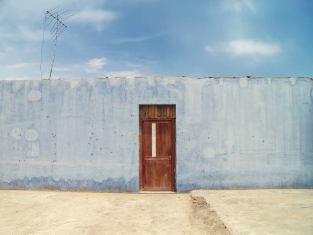 Blue wall and door stock photo