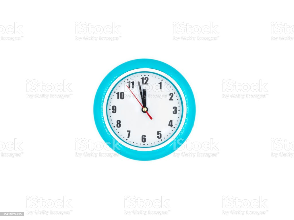 Blue wall clock on the white background, twelve o'clock stock photo