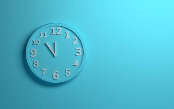 Blue wall clock stock photo