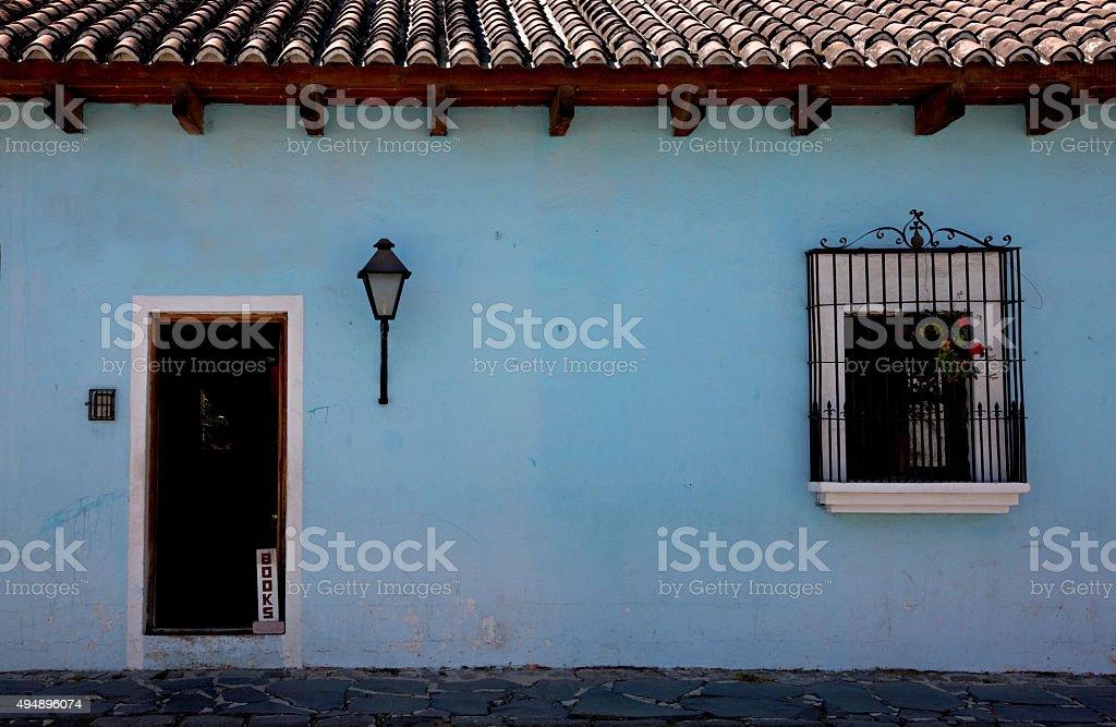 Blue wall, door and window stock photo