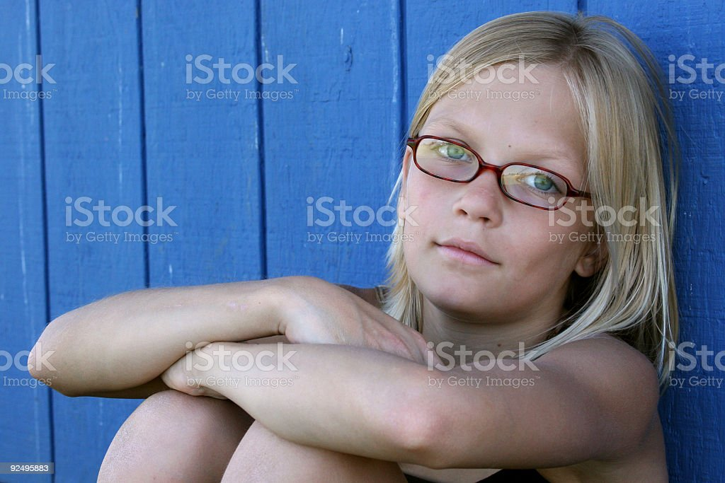 Blue wall girl stock photo