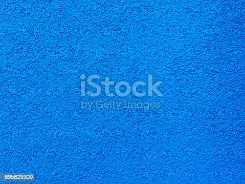 istock Blue wall texture background. Textured concrete plaster with spraying in the form of drops 895829300