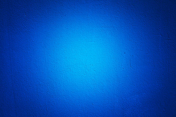 blue wall texture vignette - solid stock photos and pictures