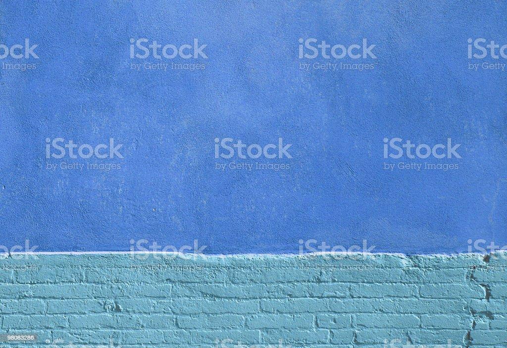Blue wall with brick base royalty-free stock photo