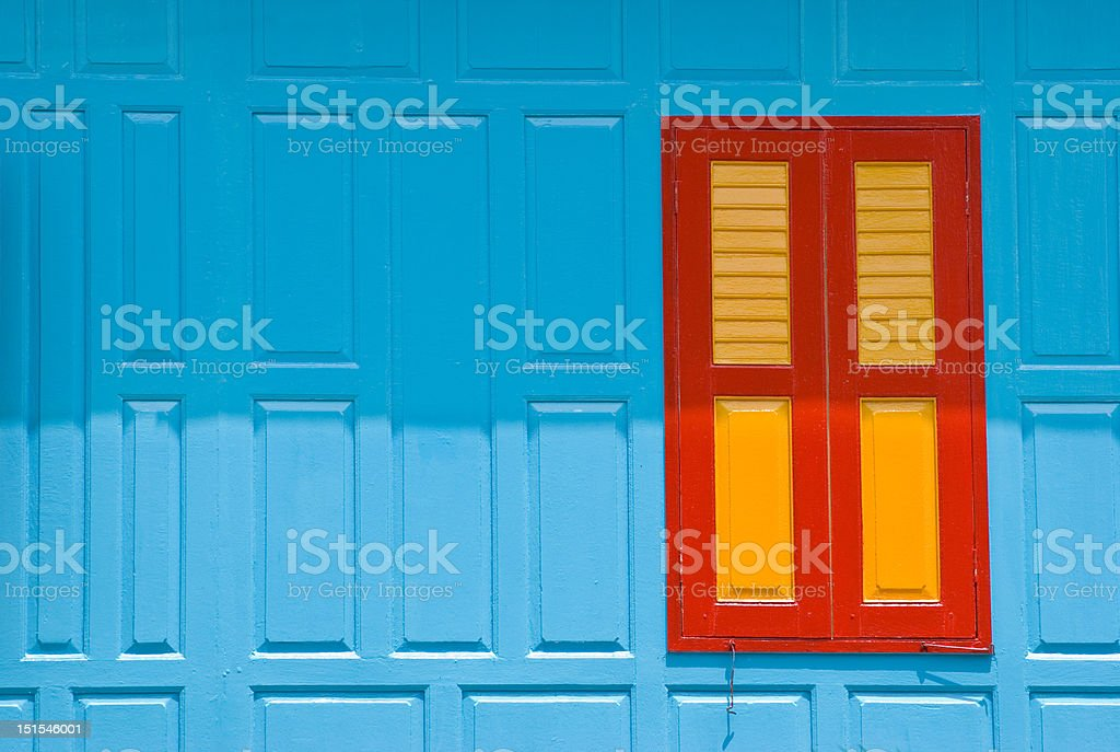 Blue wall with closed window royalty-free stock photo
