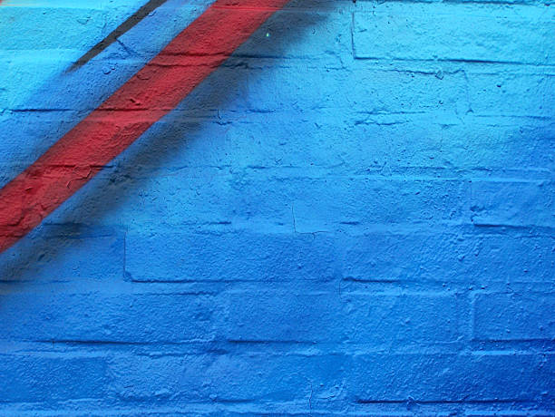 Blue wall with red line stock photo