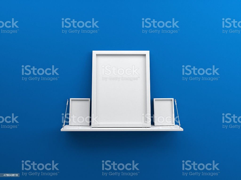 Blue wall with shelf and blank poster stock photo