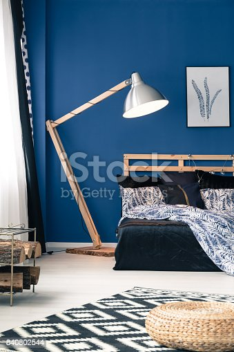 istock Blue walls and indigo bedsheet 840802544