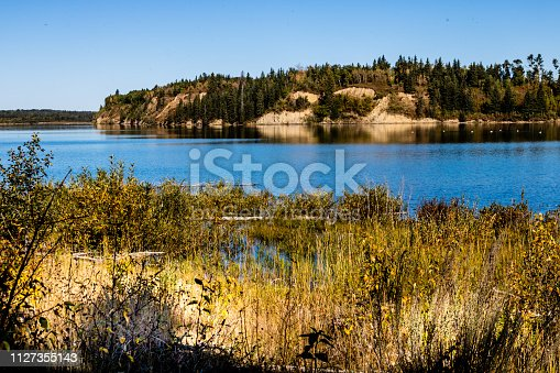 blue waters and rugged shorelines await the visotor to Gelnnifer lakes Provincial Recreation Area
