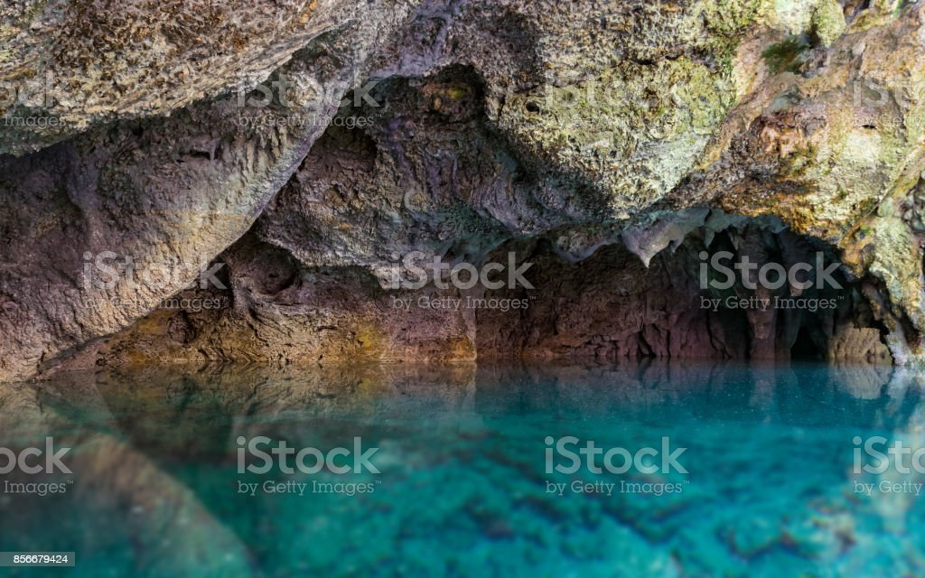 Blue water and rock stock photo