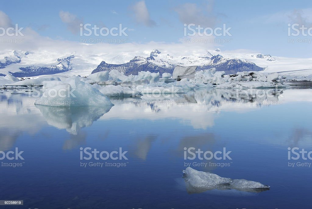 Blue water and snow capped mountains of Jokulsarlon Lagoon stock photo