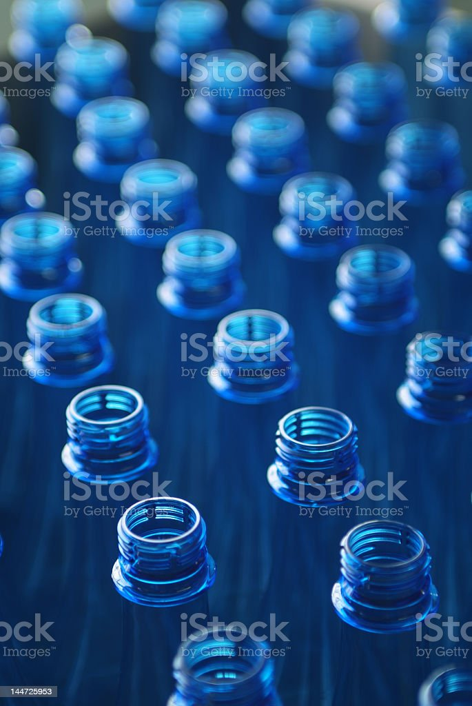 Blue water bottles in a factory royalty-free stock photo