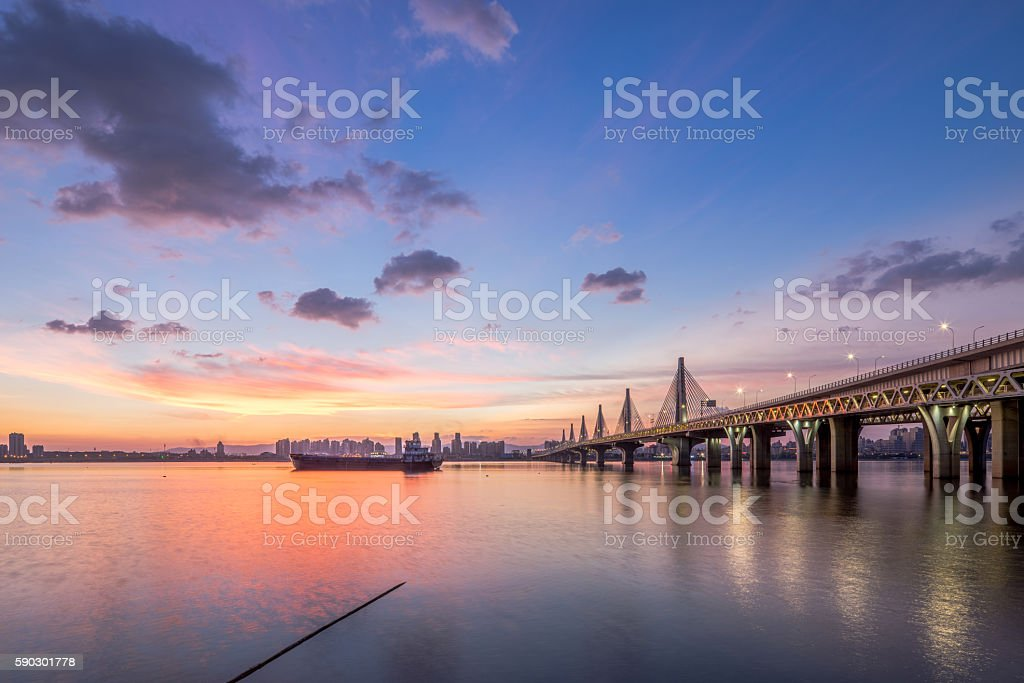 Blue Water Bridge Over   River Against Sky During Sunset royaltyfri bildbanksbilder