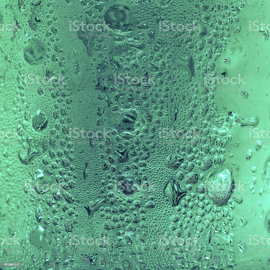 Blue water drops on glass royalty-free stock photo
