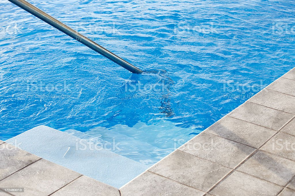 Blue water in a swimming pool royalty-free stock photo
