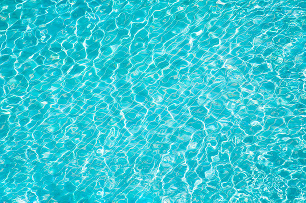 blue water in swimming pool - standing water stock pictures, royalty-free photos & images