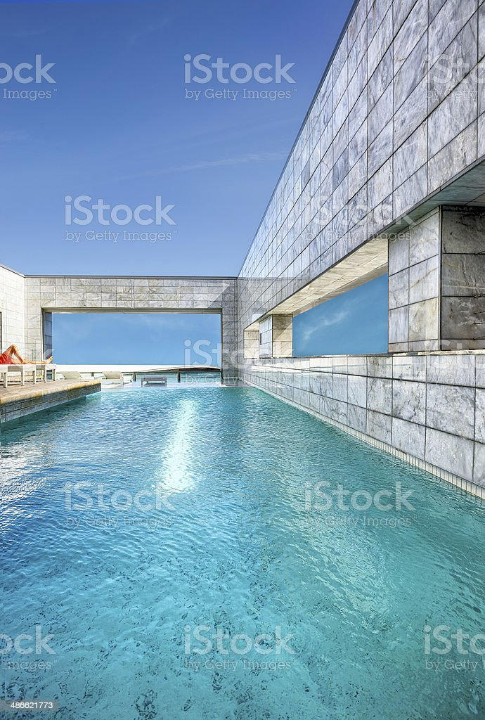 Blue water of rooftop swimming pool stock photo