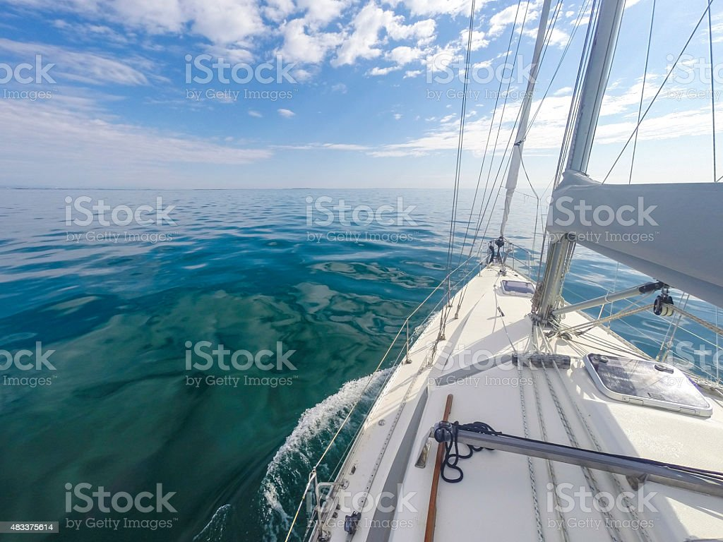 Blue Water Sailing Boat in the Sun stock photo