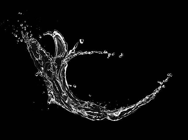 Blue water splash isolated on black background stock photo