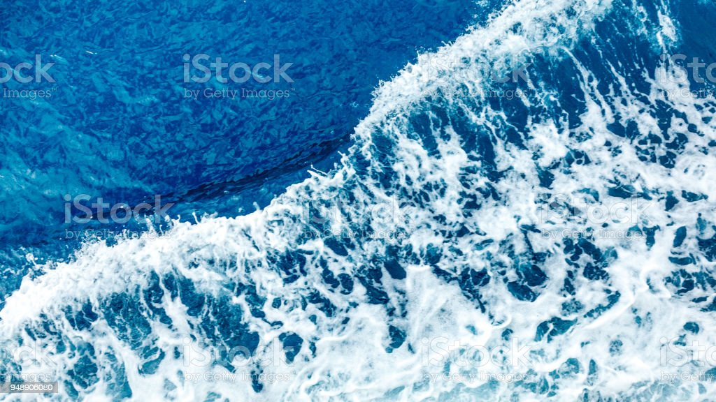 Blue water with small waves in the Aegean Sea. Abstraction: background, texture, pattern stock photo