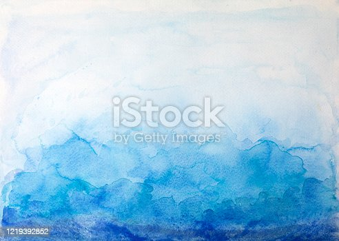 911585920 istock photo Blue watercolor background - abstract ocean 1219392852