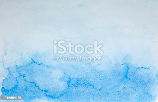Abstract wet blue watercolor background. ocean and sky, on white watercolor paper. My own work.